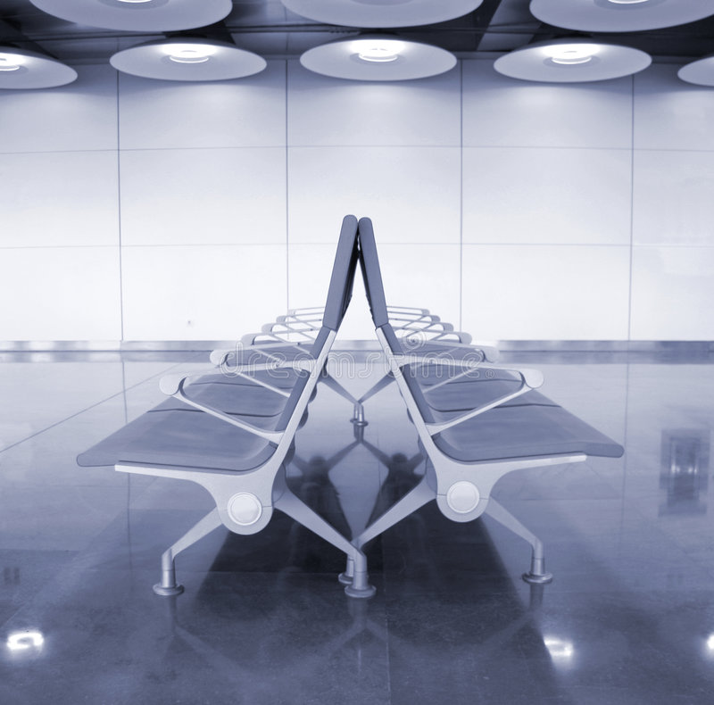 Seats. Passenger waiting lounge in airport in Madrid, Spain royalty free stock images
