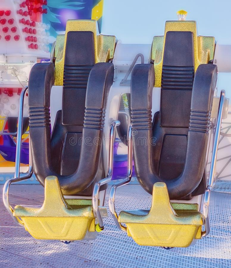 Seats Of An Amusement Park Ride. Close up of seats on a thrilling amusement park ride at a country show royalty free stock photo