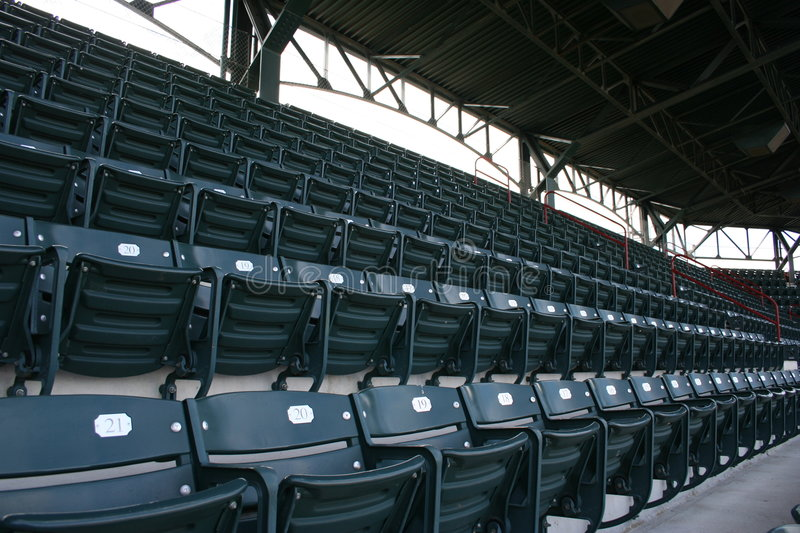 Seats at baseball stadium. A view of rows and rows of empty seats at a deserted baseball stadium royalty free stock images