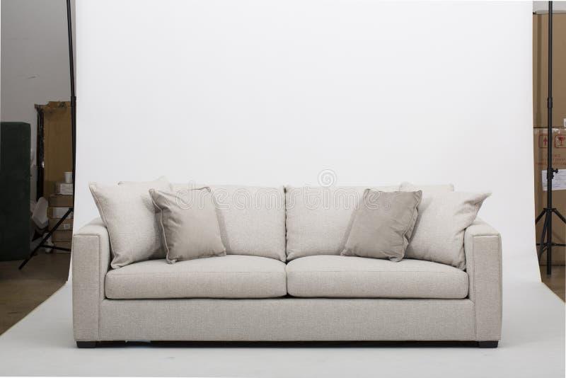Seats cozy leather sofa, 2 seater modern sofa in light grey fabric, 2-Seat Sofa, Feather Cushion Sofa,. Seats cozy leather sofa, 2 seater modern sofa in light stock images