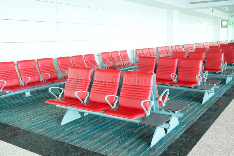 Seats in departure area in airport terminal stock photos