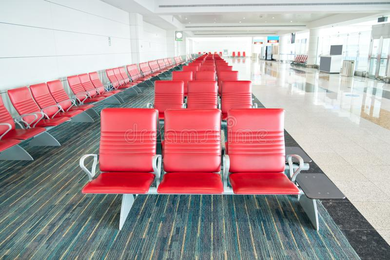 Seats in departure area in airport terminal royalty free stock images