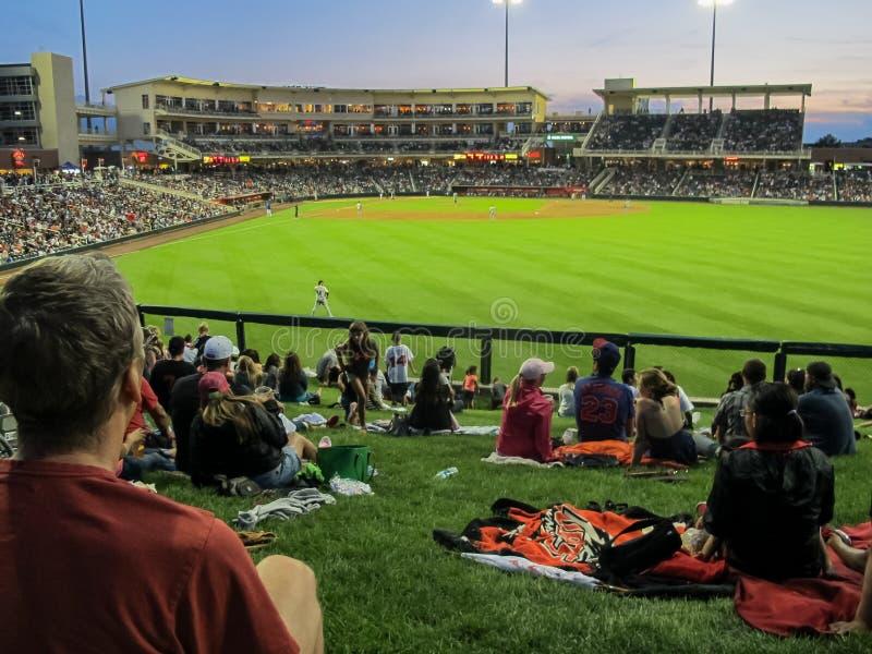Seats and fans at a baseball park stock photo