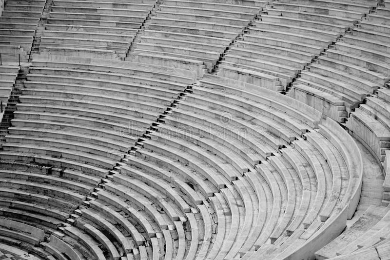 The seats of a large stadium field in black and white royalty free stock photography