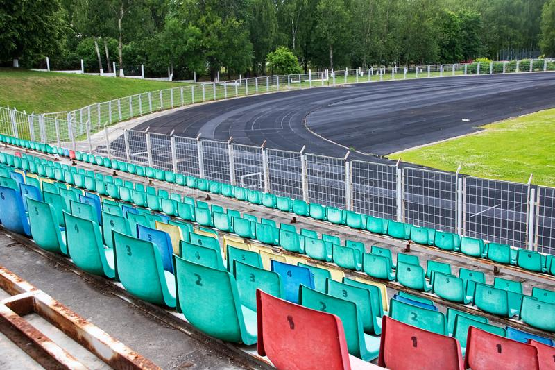 Seats and running track in the stadium royalty free stock photo