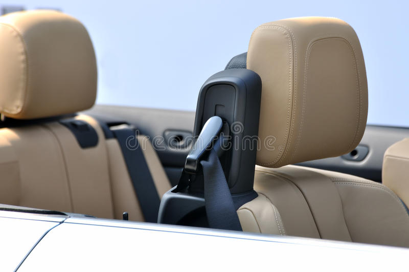 Seats of saloon style roadster. Seats with safety belt of open roadster with saloon style, shown as facilities or setup inside of a roadster stock photos