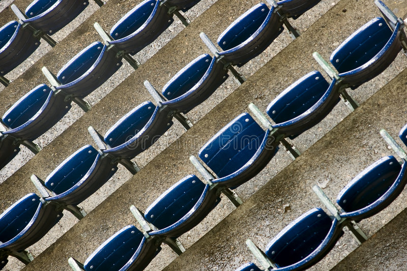 Seats at a Stadium. Seats sit empty at a stadium royalty free stock photo