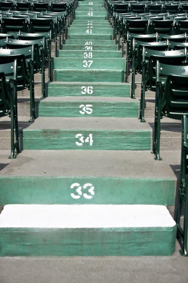 Seats at a Stadium. Seats sit empty at a stadium royalty free stock photos