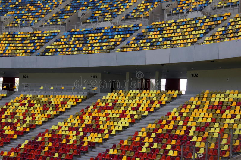 Seats at stadium. Empty seats and different colored on stadium stock photo
