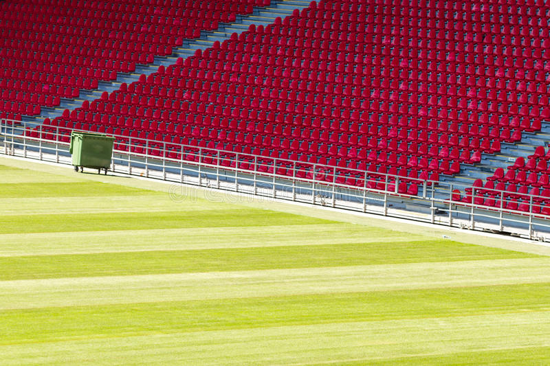 Seats at stadium. Rows of red plastic seats at large soccer stadium royalty free stock photo