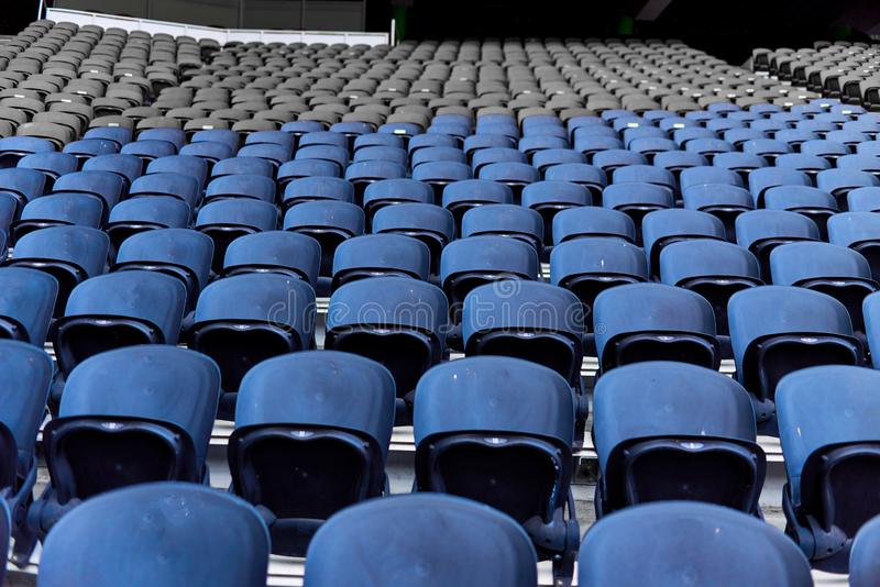 Seats in the stadium. Are arranged in rows royalty free stock photo