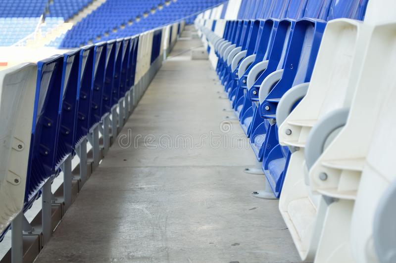 Seats at stadium. In blue royalty free stock photo