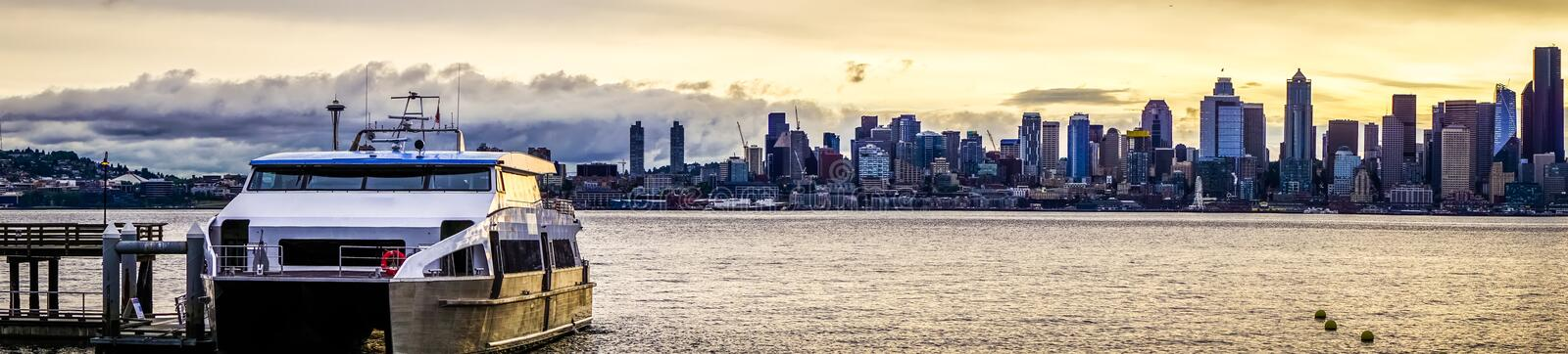 Seattle city skyline early morning with watercraft in foreground royalty free stock photography