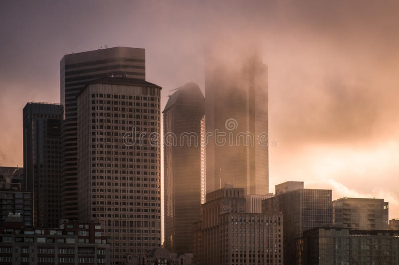 Foggy morning in Seattle City. Foggy Seattle City buildings in morning fog clouds stock photo