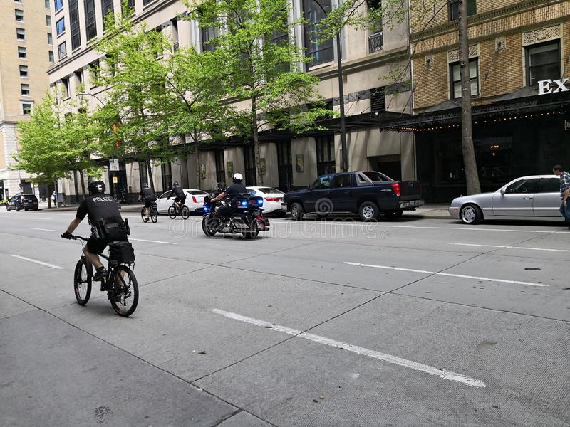 Seattle police riding on bikes royalty free stock image
