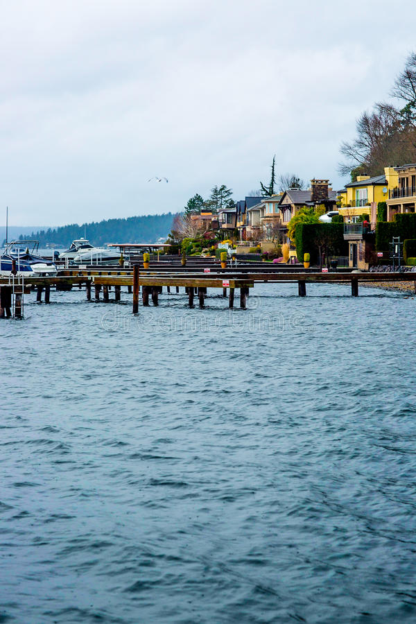 Seattle Beach Dock Puget Sound Washington State Harbor Boat Yellow Apartment Blue Water Rocks Trees Evergreen Beautiful Bay Landsc royalty free stock image