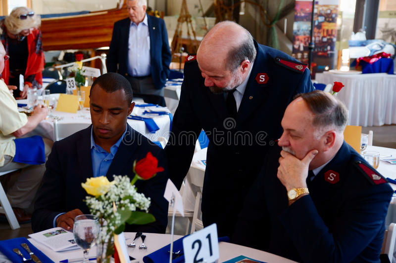 Seattle Seahawks Doug Baldwin. Major Don Sheppard, Tacoma Corps Officer and Major Doug Tollerud, Divisional Commander of The Salvation Army in the Northwest talk royalty free stock image