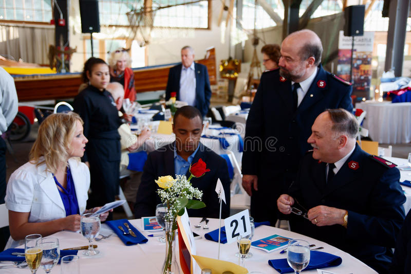 Seattle Seahawks Doug Baldwin. Major Don Sheppard, Tacoma Corps Officer and Major Doug Tollerud, Divisional Commander of The Salvation Army in the Northwest talk stock image