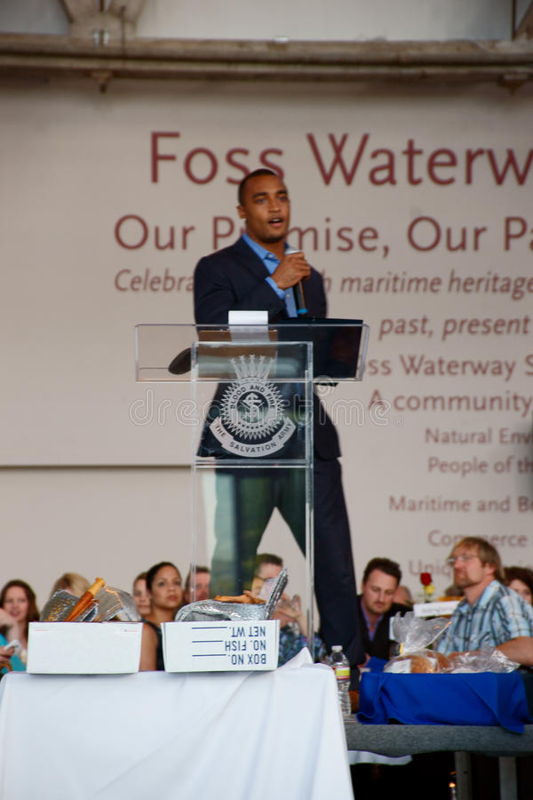 Seattle Seahawks Doug Baldwin. Doug Baldwin, wide receiver for the Seattle Seahawks was the keynote speaker for The Salvation Army in Tacoma Fishes and Loaves stock image