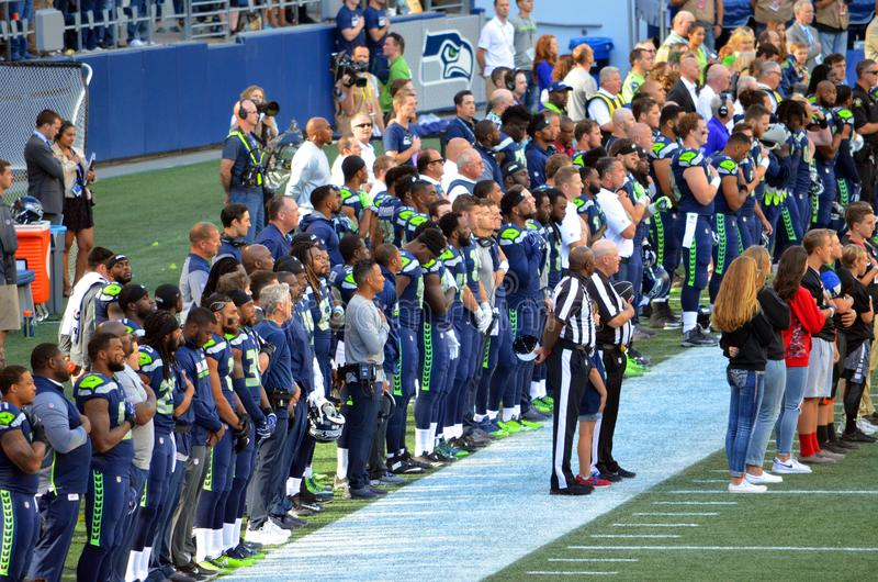 Seattle Seahawks during the National Anthem. The Seattle Seahawks show respect during the National Anthem stock images