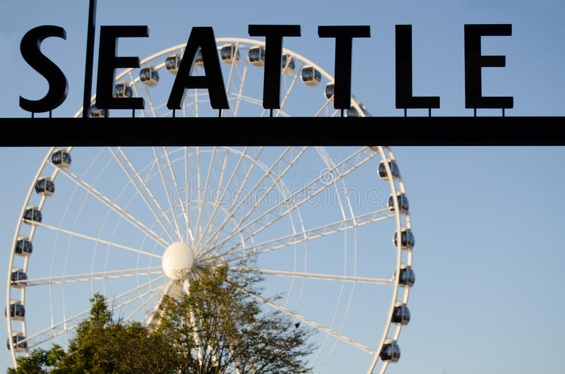 Seattle Sign and the Great Wheel. A view the the Great Wheel with the word Seattle in front of it royalty free stock photography