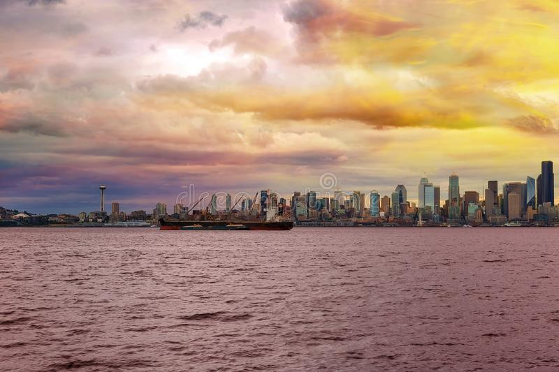 Seattle Skyline along Elliott Bay in Washington state. Seattle Washington city skyline along Elliot Bay in Puget Sound from Alki Beach during sunset stock images