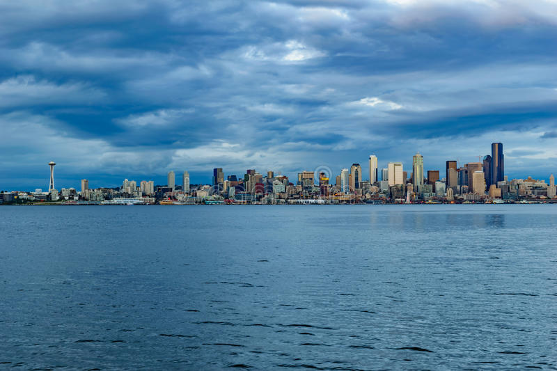 Seattle Skyline at Dusk. The downtown Seattle skyline from Alki Beach across Elliot Bay at dusk stock images