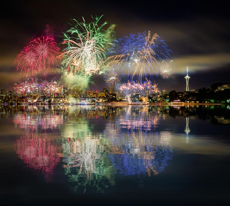 Seattle skyline and RGB fireworks with reflections. This is a photograph of Seattle skyline and RGB fireworks with reflections stock photography