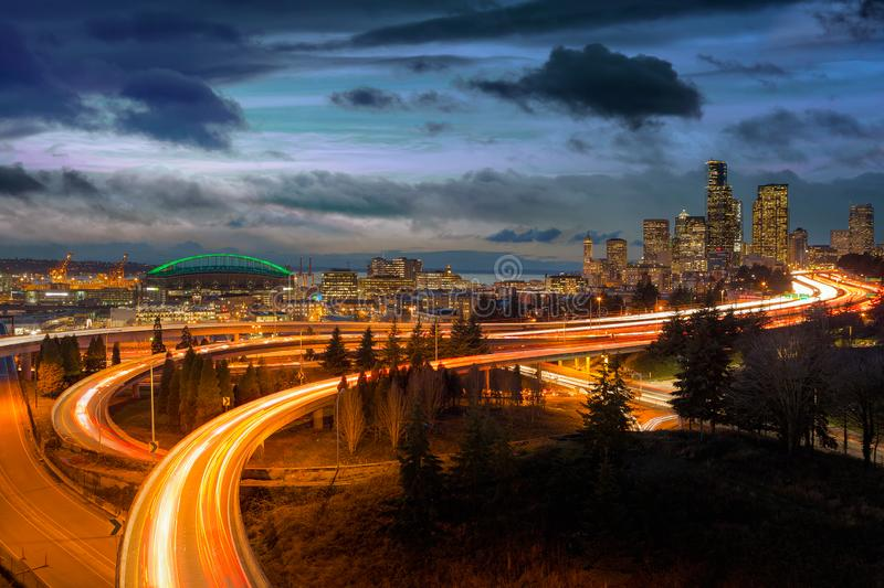 Seattle WA city skyline and freeway during sunset blue hour. Seattle Washington city skyline and freeway long exposure traffic light trails during sunset blue stock images