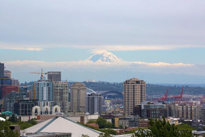 Seattle Skyline with Mt Rainier in Clouds. Seattle Washington downtown city skyline with Mount Rainier partially covered in clouds royalty free stock photography