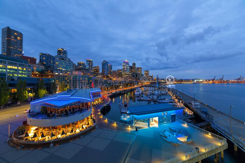 Seattle WA city Skyline from the Waterfront at Blue Hour. Seattle Washington downtown city skyline from the pier along the waterfront during evening blue hour royalty free stock photo