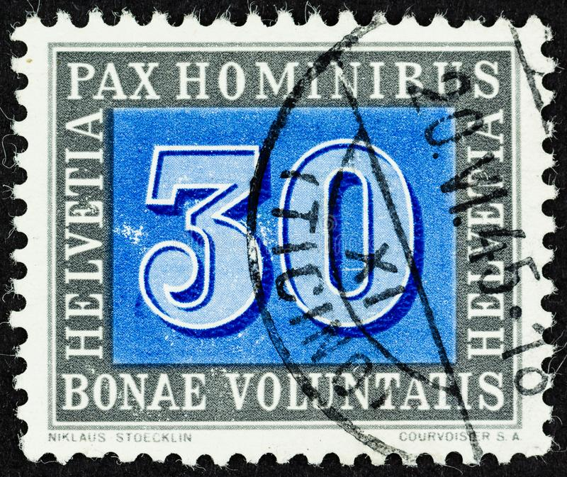 Peace Stamp from Switzerland 1945. SEATTLE WASHINGTON - June 24, 2019: 30 centime Swiss Peace Stamp issued on May 9, 1945 to celebrate the surrender of Germany stock photo