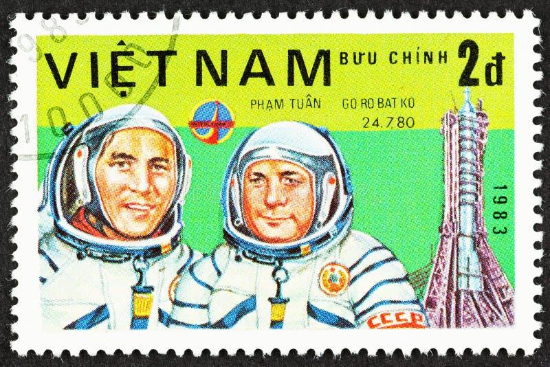 Cosmonauts of Russian Space Program. SEATTLE, WASHINGTON - September 25, 2019: Close up of stamp  featuring cosmonauts  Soviet V Gorbatko and Vietnamese Pham royalty free stock photos