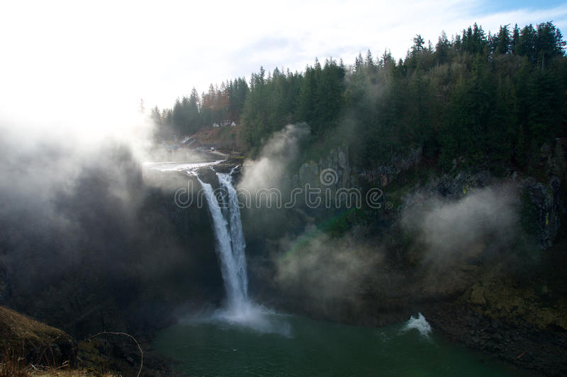 SEATTLE, WASHINGTON STATE, UNITED STATES - Jan 23rd, 2017: tree with the mist, scenic view of Snoqualmie fall when a lot. SEATTLE, WASHINGTON STATE, UNITED royalty free stock photos