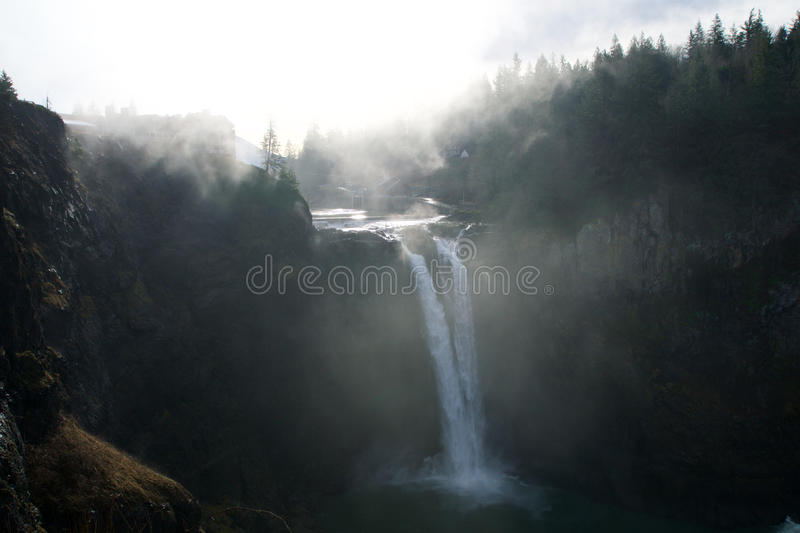 SEATTLE, WASHINGTON STATE, UNITED STATES - Jan 23rd, 2017: tree with the mist, scenic view of Snoqualmie fall when a lot. SEATTLE, WASHINGTON STATE, UNITED stock photography