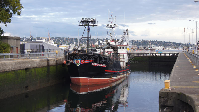 SEATTLE, WASHINGTON STATE, USA - OCTOBER 10, 2014: Hiram M. Chittenden Locks with large commercial fishing vessel docked royalty free stock photo