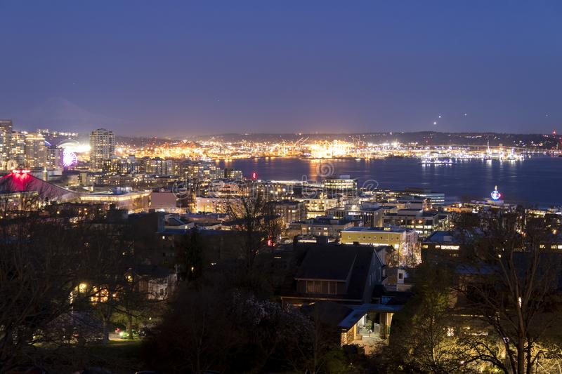 Seattle, Washington, United States. Harbor Island in the Elliott Bay and airplanes taking off and coming in to land nonstop from. Seattle airport at night royalty free stock photos