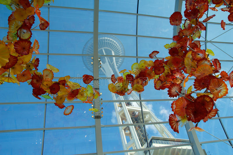 SEATTLE, WASHINGTON, USA - JAN 23rd, 2017: View of the Space Needle from inside the Chihuly Garden and Glass museum. Conservatory next door. Unique perspective royalty free stock photo