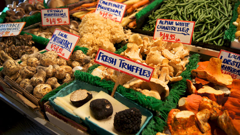 SEATTLE WASHINGTON USA - October 2014 - Mushrooms and truffles for sale in the high stalls at the Pike Place Market. stock photo