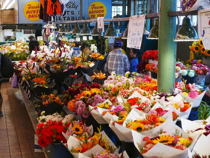 SEATTLE, WASHINGTON, USA, SEPTEMBER 4, 2015: flowers at pike place market in seattle. stock photos