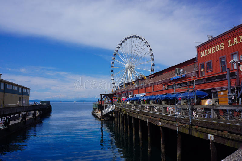 Seattle Waterfront Pier with Big Wheel stock photography