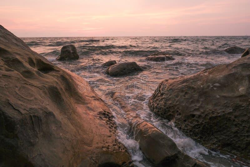 Seawaves hitting rocks on beach royalty free stock photos