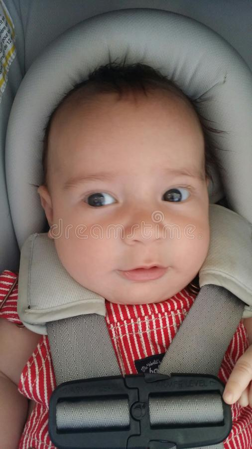 Seba's not me baby eyes looking. Baby look first-time not me naughty stock photography