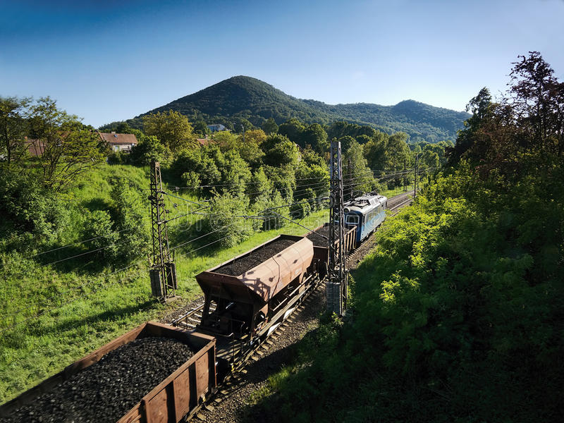 Sebuzin, Czech republic - May 19, 2017: Freight train with coal running afternoon spring landscape royalty free stock images