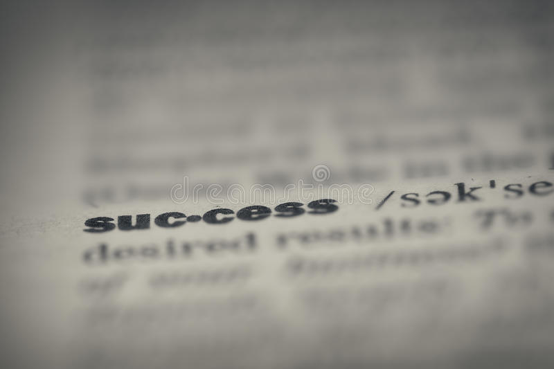 Seccess. 'Success' word in English dictionary , extreme close up. Retro style toned photo with shallow DOF stock photo