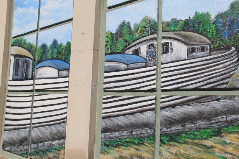 Secciones del edificio pintadas con escena a partir del apogeo misterioso del canal, Syracuse, Nueva York, 2017 fotografía de archivo