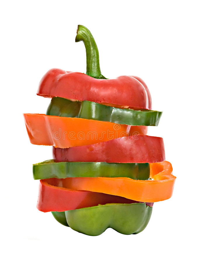 Secciones longitudinales de pimientas dulces coloridas imágenes de archivo libres de regalías