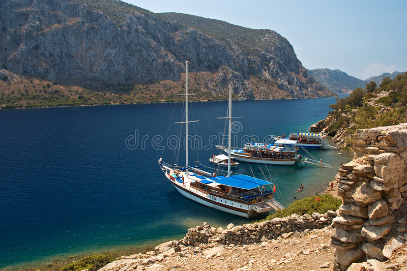 Secluded Bay. Tourist Boats in Secluded Bay stock images