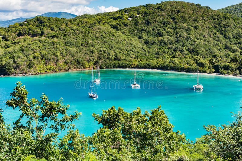 Secluded bay with sailboats. Small bay with sailboats on St. Johns Island in the Caribbean royalty free stock photo
