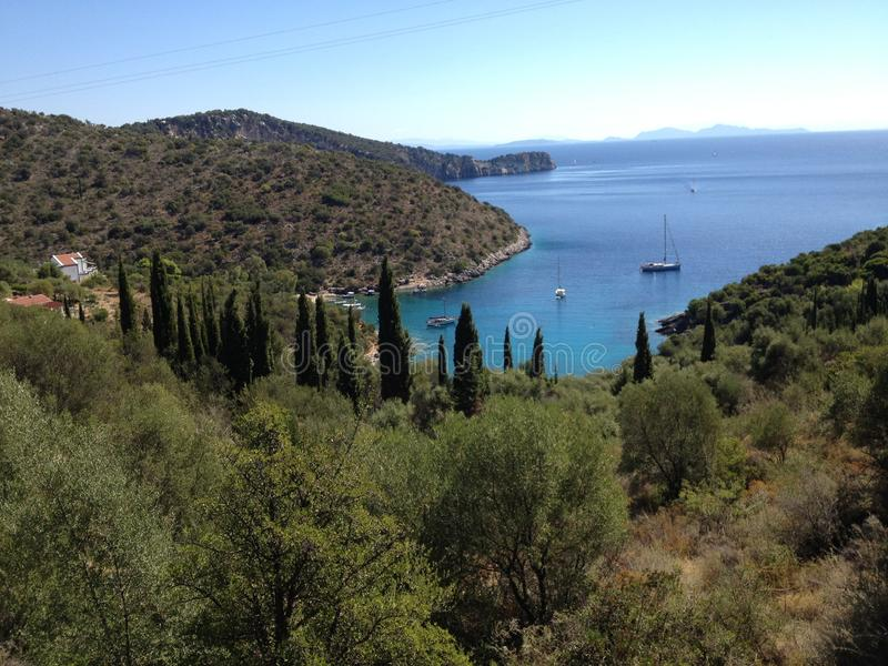 Secluded bay and sailing boats, Greece islands stock photos